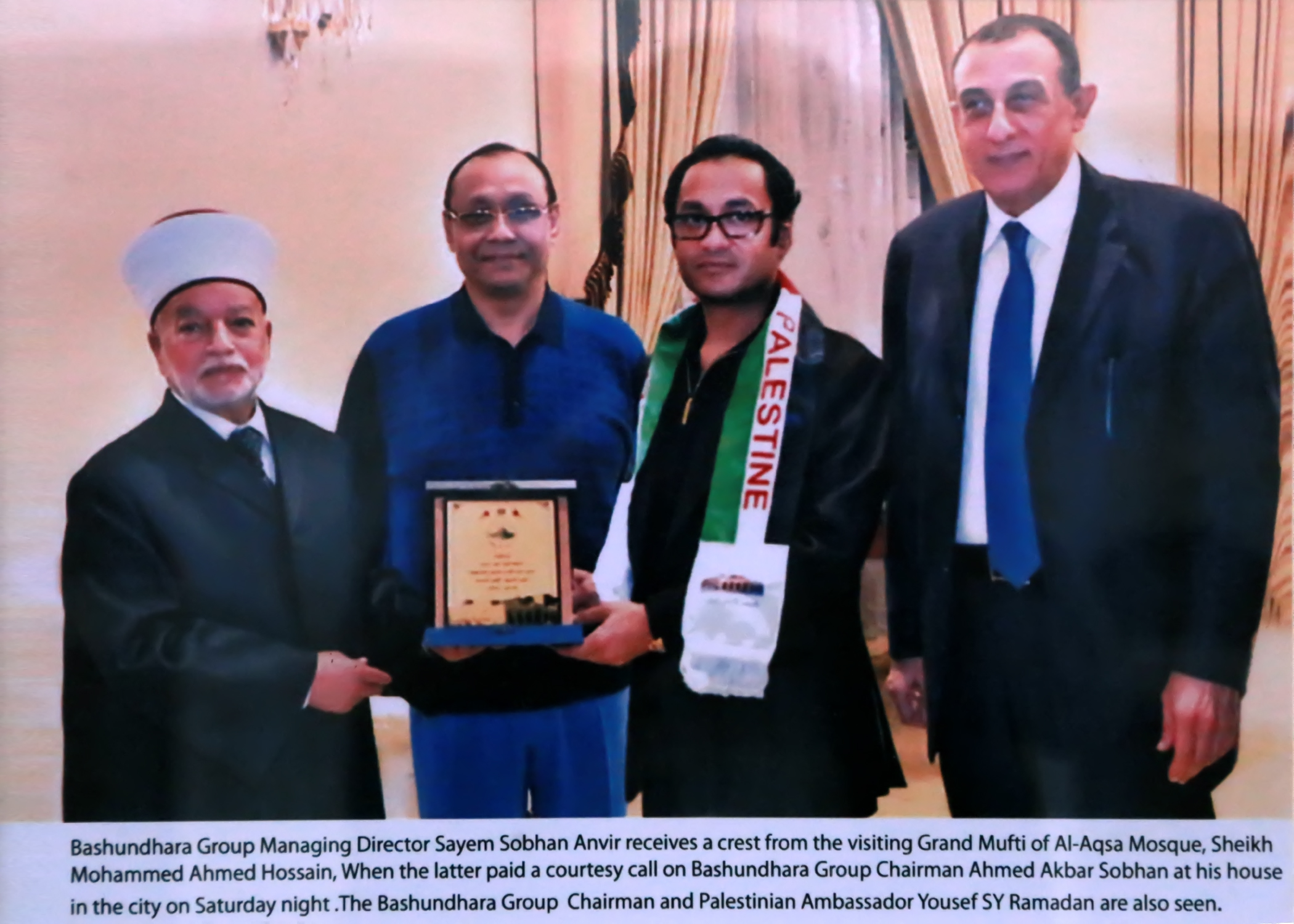 Bashundhara Group Managing Director Sayem Sobhan Anvir receives a crest from the visiting Grand Mufti of Al-Aqsa Mosque, Sheikh Mohammed Ahmed Hossain, When the latter paid a courtesy call on Bashundhara Group Chairman Ahmed Akbar Sobhan at his house In the city on Saturday night .The Bashundhara Group Chairman and Palestinian Ambassador Yousef SY Ramadan are also seen.